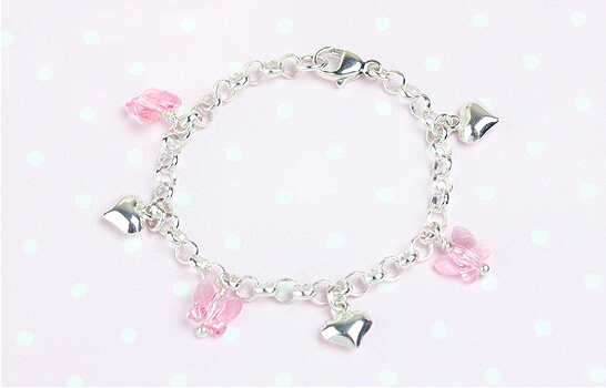 Baby charm bracelet with hearts and butterflies.