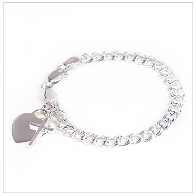 Traditional charm bracelet with engraved heart and polished Cross charms.