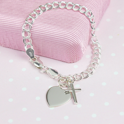Girls sterling charm bracelet with engraved heart.