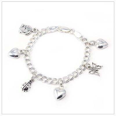 Children's sterling charm bracelet with six charms included.