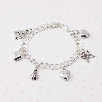 Traditional charm bracelet for girls with puffed hearts and animals.