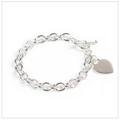 Girls sterling wide link charm bracelet with engraved heart.