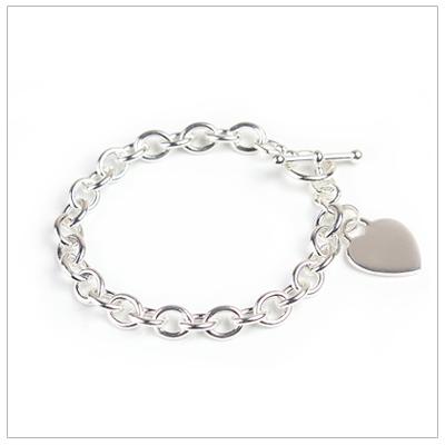 Girls sterling wide link charm bracelet with engraved heart.