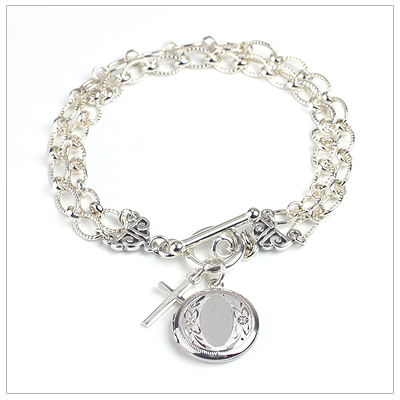 Sterling silver charm bracelet with engraved round locket plus additional free charm.