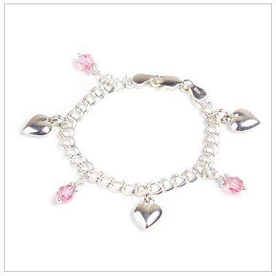 Girls charm bracelet with three hearts and three birthstone charms.