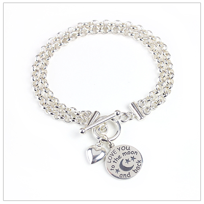 Double strand charm bracelet in sterling silver with two included charms.
