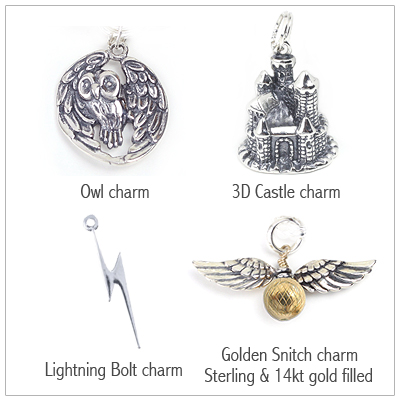 Sterling silver owl charm, castle charm, lightning bolt charm, and golden snitch charm.