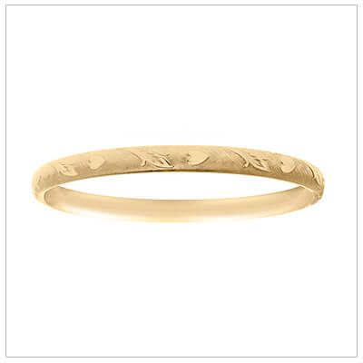 14kt gold filled children's bangle bracelets in a rare 5 3/4 inches. The bangle is engraved with a floral and hearts pattern.