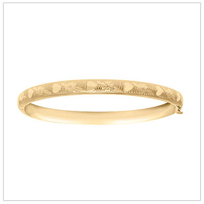 14kt gold filled childrens bangle bracelet with an engraved pattern of hearts and flowers. Our childrens bracelets have a safety hinge closure.