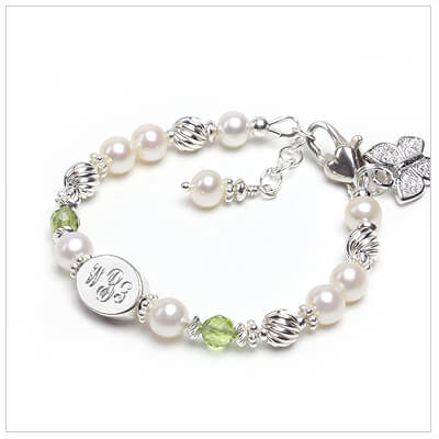 Fine cultured pearl bracelet with genuine birthstones and custom engraving.