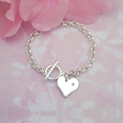 Sterling toggle style baby ID bracelet with a genuine diamond. Engrave her initial on the heart charm.