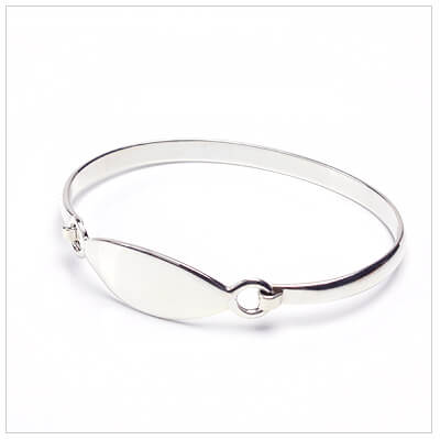 Engraved silver bangle bracelet for children with a marquise shaped front.