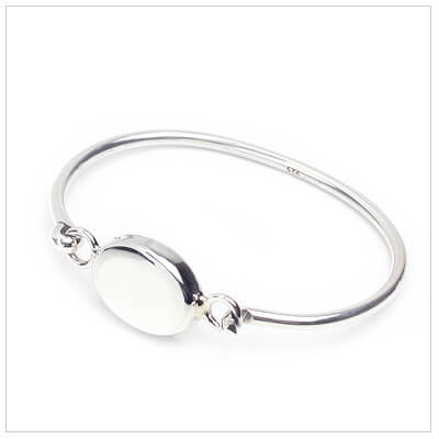 Silver bangle bracelet for toddlers with puffed oval front in a 5 inch size; engraving included.