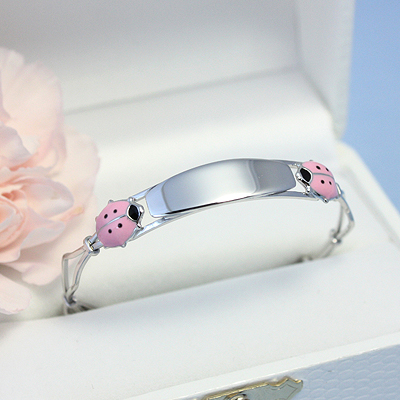 Engraved Bracelets with two pink ladybugs on an adjustable silver bangle