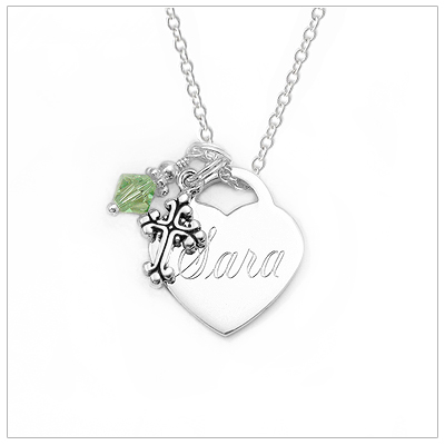 Sterling silver engraved heart necklace for children. Free front engraving and free birthstone charm. Choose additional charms to add to the necklace.