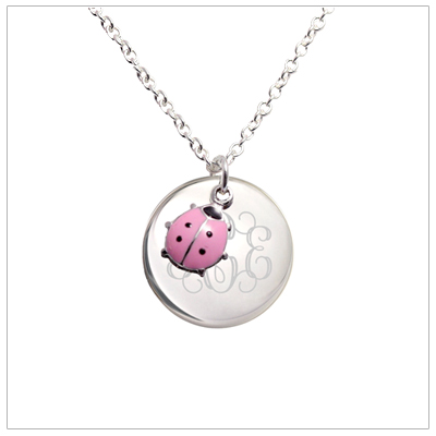 Engraved sterling silver necklace for children with a pink ladybug swinging from the charm. Necklace includes sterling chain.