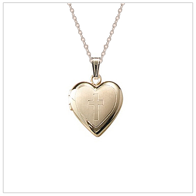 Children%27s gold filled heart locket engraved with a Cross. Precious locket for children holds two small photos.