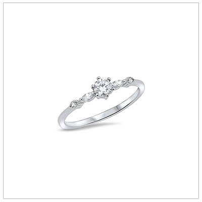 Dainty sterling silver ring for children with clear cubic zirconia. A sparkly ring available in 2 sizes.