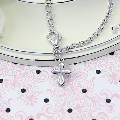 Girls charm bracelets in sterling silver with a beautifully shaped diamond Cross. Adjustable size.