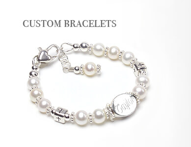 Custom engraved christening and baptism bracelet. Cultured pearl baby bracelet with sterling silver engraved bead and Cross beads.