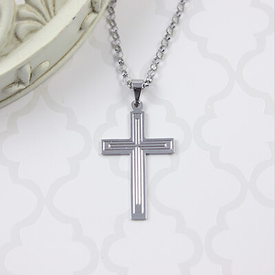 Our white gold cross necklace is a favorite for boys! The 14kt chain is included with our Cross necklace.