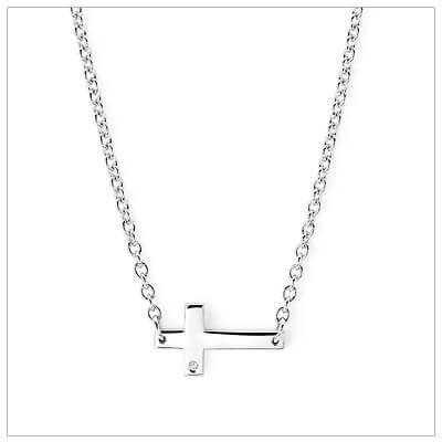 Popular sideways cross necklace in polished sterling silver and set with a melee diamond.