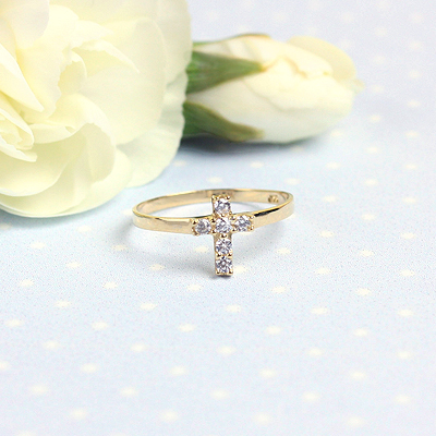 Children's 14kt gold Cross ring set with sparkling cz. The Cross ring makes a perfect gift for First Communion or other special occasions.