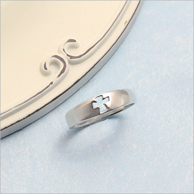 Children's silver ring with a cut out Cross design. Our children's ring available in 3 sizes.