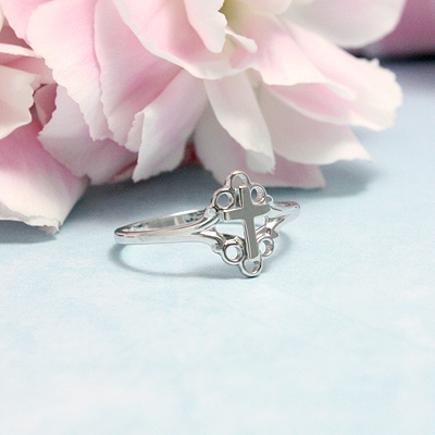 Sterling silver Cross ring for girls with a scrolled border around the Cross.
