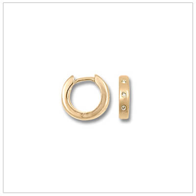 14kt gold huggie earrings set with genuine diamonds. Our gold huggie hoop earrings are perfect for children and teens.