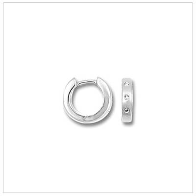 14kt white gold huggie hoop earrings set with three genuine diamonds. Beautiful white gold earrings.