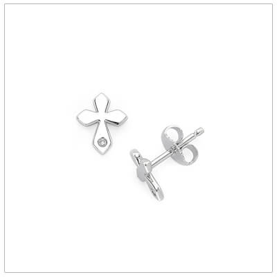 Dainty diamond Cross earrings for babies and children. The Cross earrings are sterling silver and have push on backs.