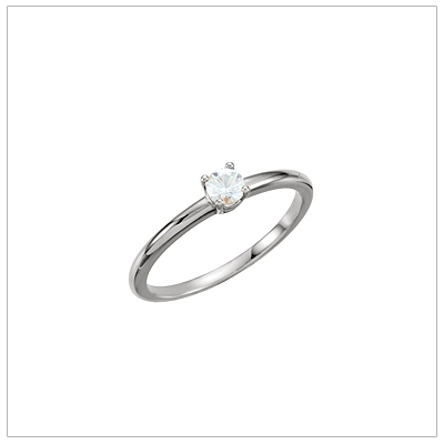 Childrens diamond ring in 14kt white gold with genuine solitaire diamond.