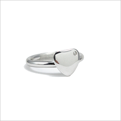 Heart shaped ring for teens with genuine diamond. Sterling silver ring can be engraved with one initial.