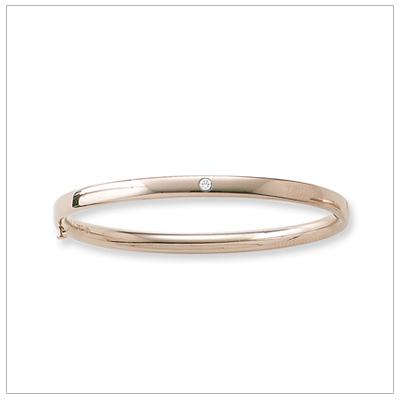 Gold bangle bracelet with genuine diamond.