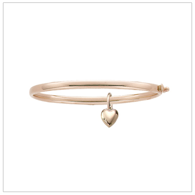 14kt gold bangle bracelet for girls with a free moving gold heart charm; sized for children.