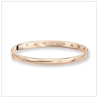 14kt gold bangle bracelet with hearts all around. Safety clasp. Child size 5.25 in. bangle bracelets.