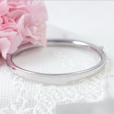 14kt White Gold Bangle Bracelets 4.5 inches with polished finish and safety clasp for babies