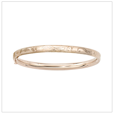 14kt gold bangle bracelet with an engraved floral design sized for babies and toddlers with safety hinge.