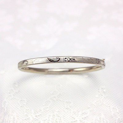 14kt gold bangle bracelet for girls with an engraved floral design. Child size 5.25 inches.