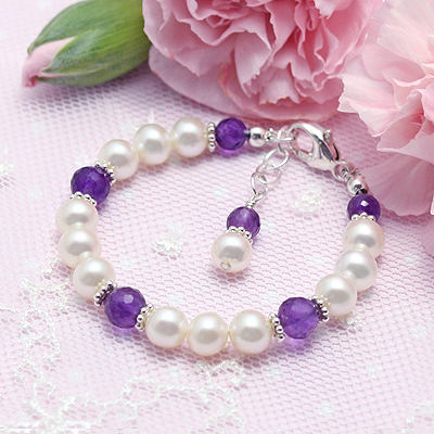 Cultured pearl bracelet for girls with genuine faceted amethyst. Add an engraved bead to the bracelet.