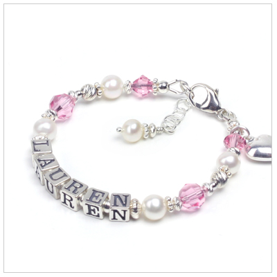 Personalized name bracelet for children with Swarovski birthstone crystals and sterling silver.