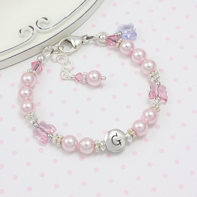 pearl bracelet has charming crystal butterflies set among pearls and a free butterfly charm is included!