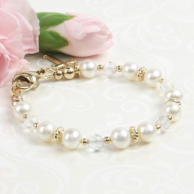 14kt gold and white pearl bracelet for girls with a 14kt gold Cross charm included.