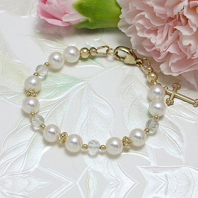 Cultured pearl bracelet with 14kt gold and faceted white topaz beads. Cross included.