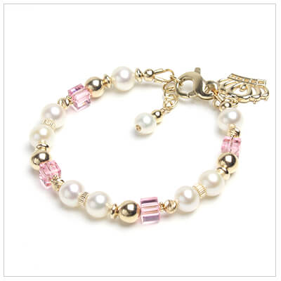 White cultured pearl and 14kt gold baby bracelet with soft pink crystals. Shown with 14kt gold crown charm.
