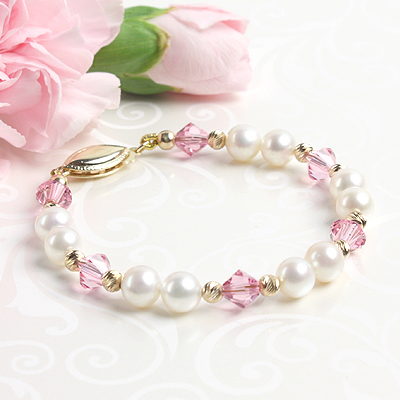 Gold baby and child bracelet with white pearls and sparkling diamond cut gold.