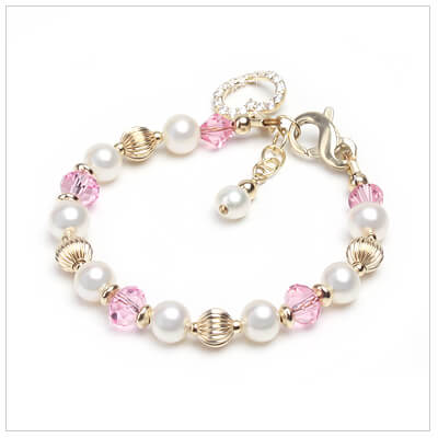 14kt gold and pearl baby and childrens bracelet with pink crystal.