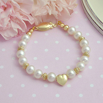 Gold baby bracelets in cultured pearls and 14t gold heart. Heirloom Collection. Baby and child.