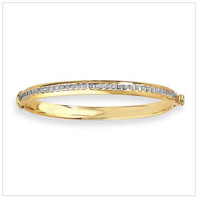 14kt gold child's bangle with diamonds across front.